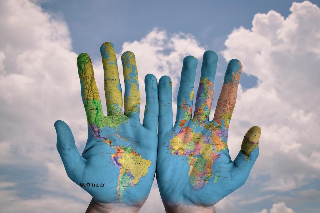 world-hands-business-travel